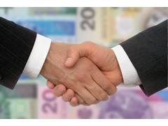 bigstockphoto_Business_Handshake_257238